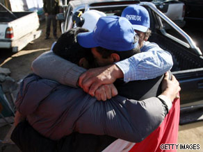 Relatives of trapped miners celebrate news that rescue is near.