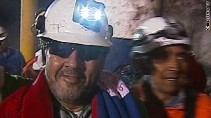 Luis Urzua, the last of the 33 miners to be rescued, emerges from the capsule about 22 hours after the rescue operation's final phase began.