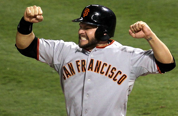 Cody Ross celebrates after scoring on a three-run hit by Giants teammate Edgar Renteria in Game 5 (Getty Images).