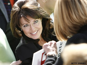 Sarah Palin greets supporters during a rally.