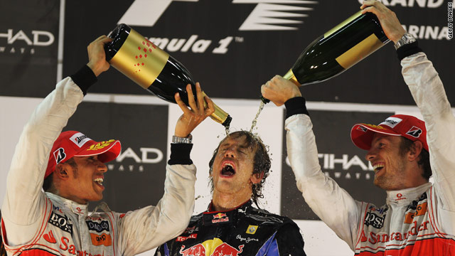 Champions all. 2008 and 09 F1 title winners Hamilton and Button celebrate with Vettel.