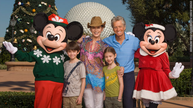 Michael Douglas and family hang with Mickey Mouse