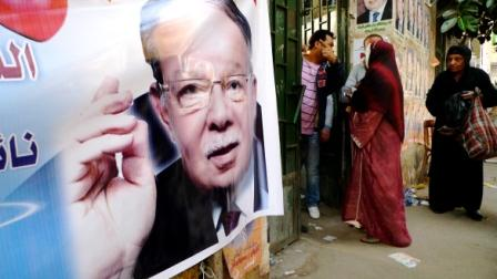 Outisde a voting station in the Sayida Zainab area of Cairo, An NDP party candidate's poster dominates (Mary Rogers/CNN)