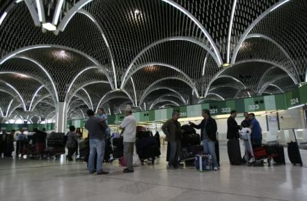 Passengers wait at ticket counter at Baghdad International Airport (Getty Images )
