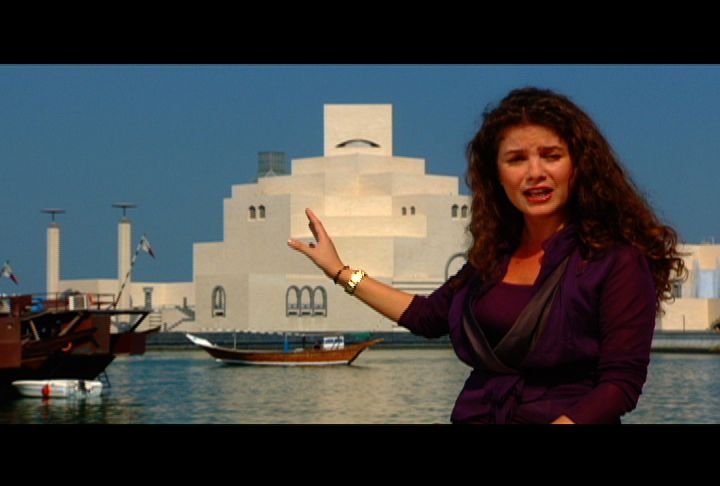 Rima Maktabi on Doha&#039;s corniche in front of the iconic Museum of Islamic Art.