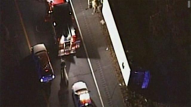 30 hurt when bus rolls over on highway