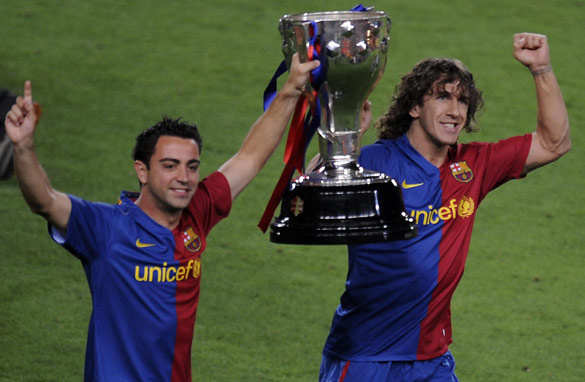Can Barcelona stars Xavi, left, and Carles Puyol lift the Champions League trophy again this season? (Getty Images)