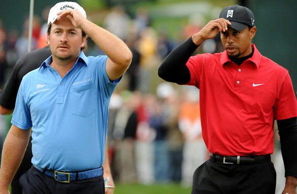 Tiger Woods, right, lost to Graeme McDowell in a playoff at the charity tournament he hosts. (AFP/Getty Images)