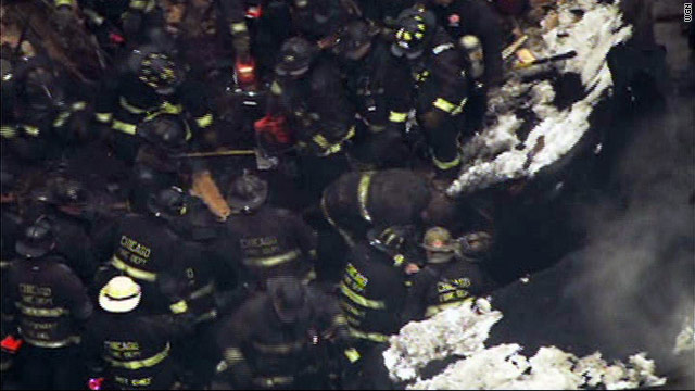 Two firefighters dead, 14 injured after roof collapse