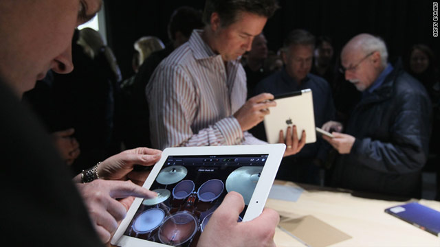 An attendee of Apple's iPad 2 news conference tests the white version of the tablet computer.