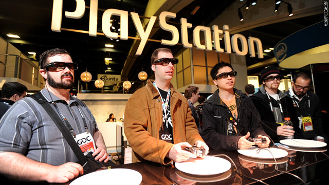 "Gamers play ""Mortal Kombat 3D"" on a PlayStation 3 at a game developers conference in March."