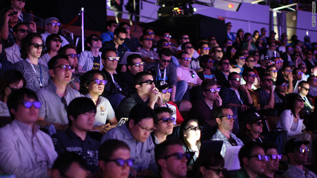 One barrier to 3-D TV adoption is the required glasses, like the ones attendees wore at June's Electronic Entertainment Expo.