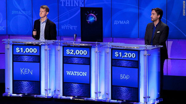 """Jeopardy!"" champs Ken Jennings, left, and Brad Rutter match wits with IBM's computer Watson on the popular game show."