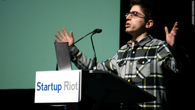 Adam Geller gives his three-minute pitch for R3 Collaboratives, a video platform for teacher training, at Startup Riot.
