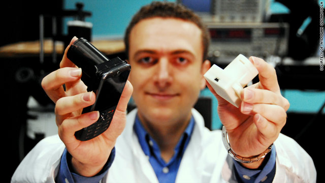 UCLA associate professor Aydogan Ozcan with his cell phone microscope which he hopes will revolutionize disease detection