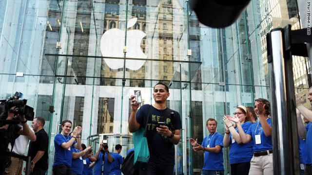 A shopper emerges from Apple's flagship store in New York City with an iPhone 4 in June 2010.