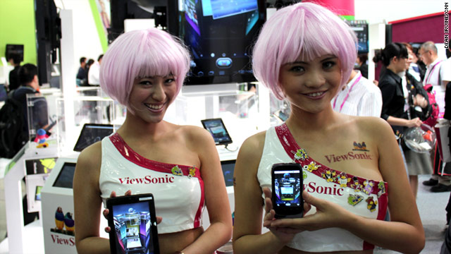 Computex showgirls advertise the products on offer at the fair