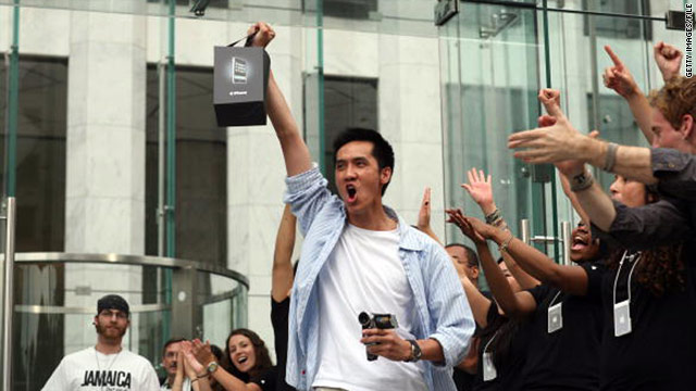 The original iPhone went on sale on June 29, 2007. Here, a proud owner diplays one outside Apple's flagship store in New York.