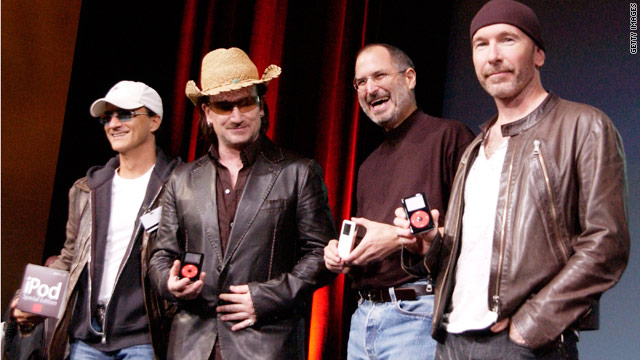 Steve Jobs, third from left, and members of the band U2 celebrate the launch of an Apple iPod in 2004.