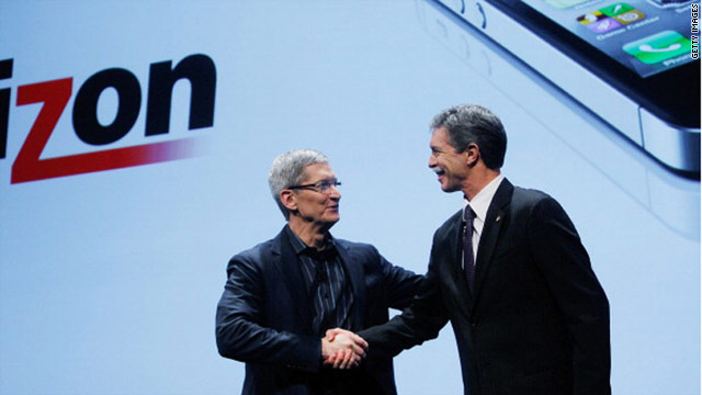 Apple COO Tim Cook, left, greets Verizon Wireless CEO Dan Mead during the iPhone announcement Tuesday in New York.