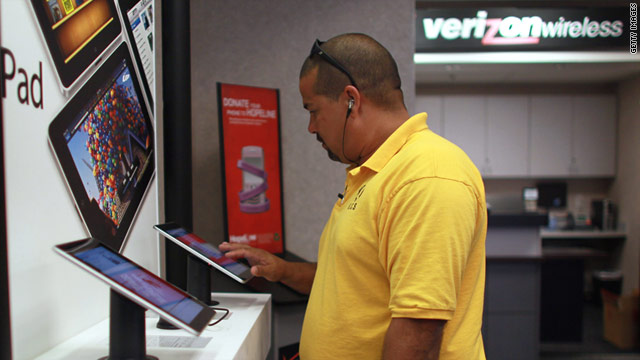Heriberto Cazanas checks out the iPads on display at a Verizon store in Coral Gables, Florida.