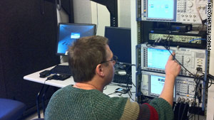 Verizon engineers test the key aspects of phones. In the room pictured, software checks a device's audio output.