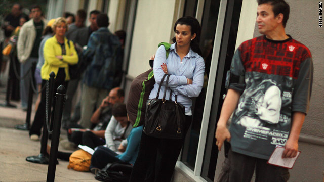 Customers wait in line Thursday to buy the new Verizon iPhone in Coral Gables, Florida.