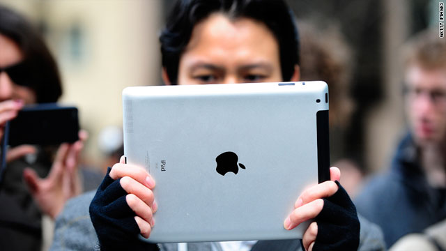 A man tests the iPad 2 at the Apple store on Fifth Avenue in New York in early March.