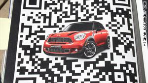 A QR code promotes Mini Cooper cars.