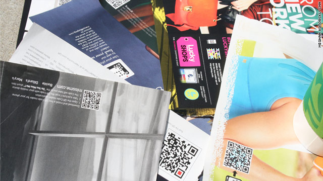 Brands such as Macy's are using black-and-white QR, or Quick Response, codes in magazine ads to market themselves.