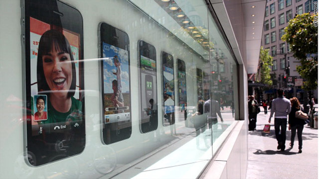 Pedestrians pass an Apple store in San Francisco, which is requiring displays about radiation emitted by cell phones.
