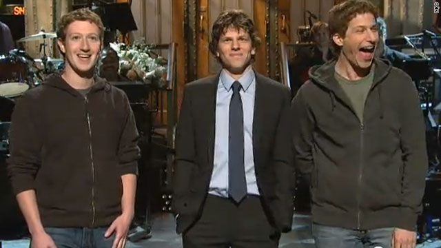 Mark Zuckerberg, left, appears on stage with Jesse Eisenberg and SNL player Andy Samberg.