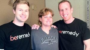 Blake Canterbury, left, and Brian Sudduth smile with Kecia Cruz.
