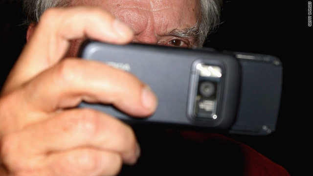 Photographer David Bailey tests a Nokia smartphone, which captures more detailed data than most regular cameras.