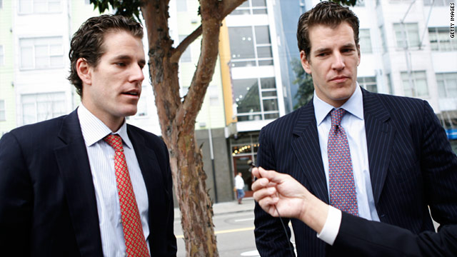 Cameron, left, and Tyler Winklevoss speak to reporters as they leave the U.S. Court of Appeals in San Francisco.