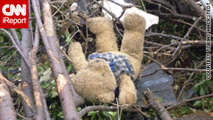 A CNN iReporter posted this photo of a teddy bear lying in debris in tornado-ravaged Tuscaloosa, Alabama.