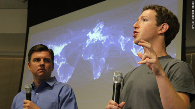 Skype CEO Tony Bates listens Wednesday as Facebook's Mark Zuckerberg describes his site's new video chat feature.