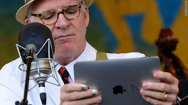 "Steve Martin, shown here with his iPad, has been tweeting ""from"" CES this week."
