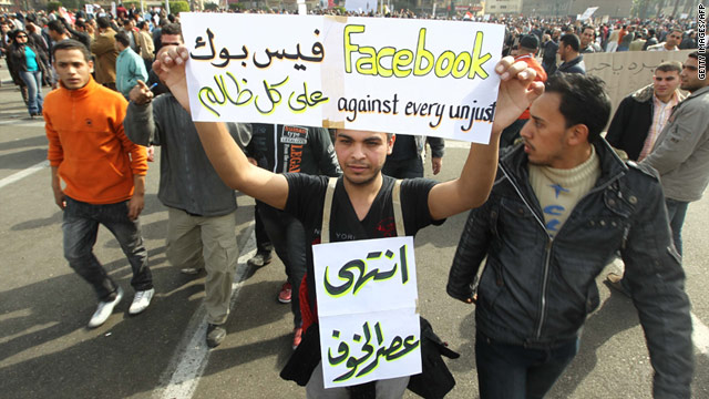 Internet access was returned to parts of Egypt on Wednesday. A protester on Tuesday holds up a sign in support of Facebook.