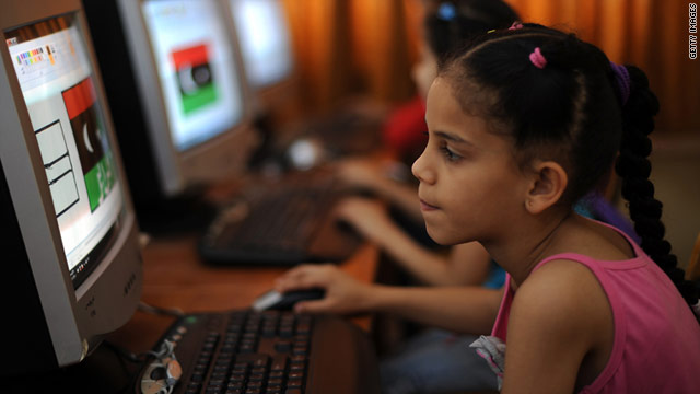 A Libyan girl uses a computer in June at a school organized by volunteers to keep children occupied far from the fighting.