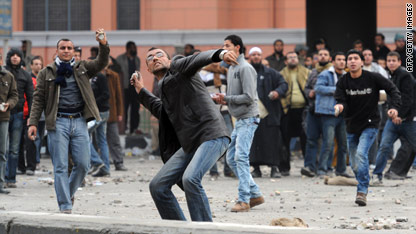 Protesters throw rocks in central Cairo Thursday.