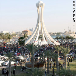 Bahrain protesters camp beneath capital landmark