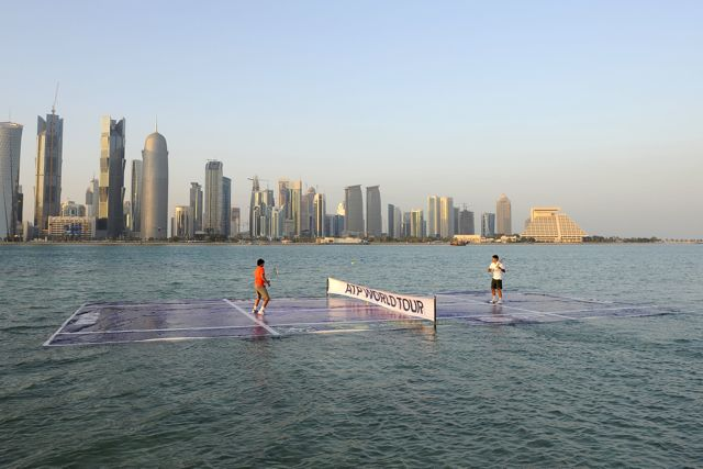 Photo: Crosnier/QTF.  Rafael Nadal and Roger Federer kicked off the 2011 ATP World Tour season in Doha yesterday by hitting tennis balls on a court laid in the water of Doha Bay.