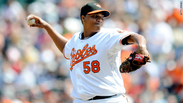Orioles pitcher surrenders to police on murder charge