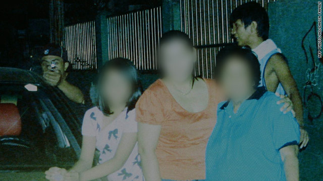 Slain Filipino councilman caught killer in family photo