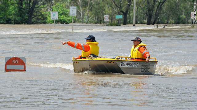 Evacuations in Australia proceed as floodwaters rise