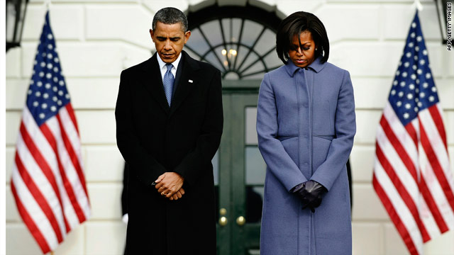 Obamas lead nation in moment of silence
