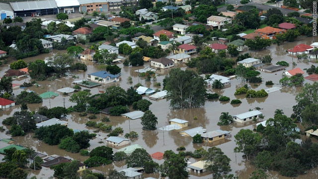 Dozens still missing as floodwaters peak in Brisbane