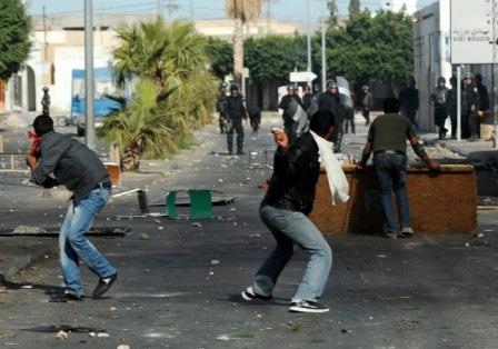 Tunisian demonstrators hurl objects towards security forces. (Getty Images)