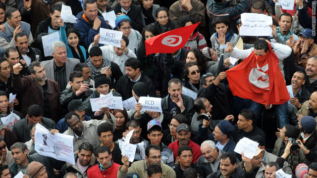 Protesters march in Tunis amid Arab League fears